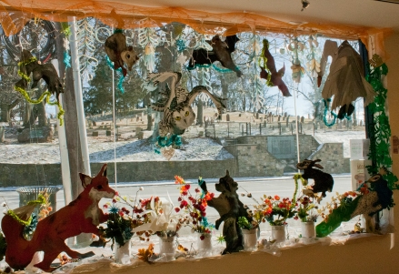 Window interior view Created cardboard cutouts and painted them, with mixed media ornaments.